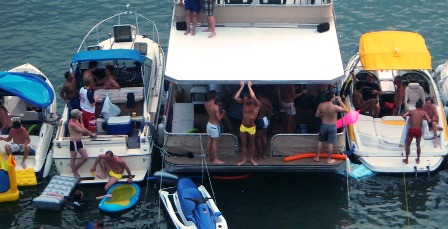 shirtless guys on boats