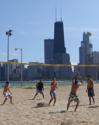 shirtless boys playing volleyball beach