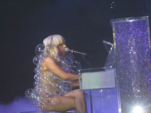 lady gaga plays piano wearing bubbles